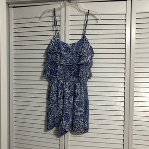 Blue and white patterned romper size M